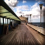 Boardwalk: Bournemouth Pier, on a Sunday morning.